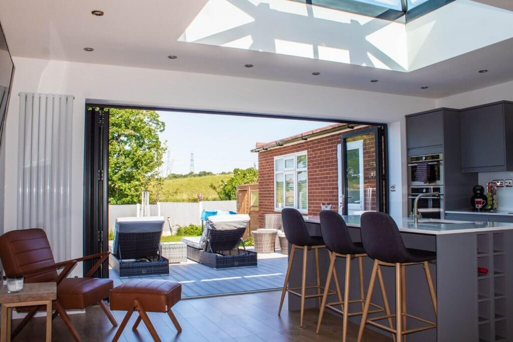 How much warmer is an orangery compared to a conservatory?